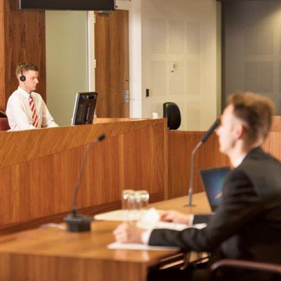 Transcribing taking place in a courtroom
